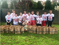 JFK-RCK Football Players Feed 40 Families in Need
